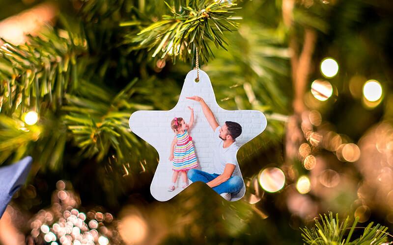 Estrela de Natal com foto na árvore
